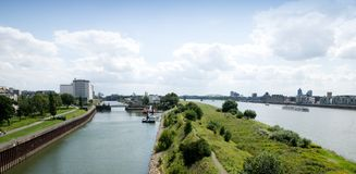 Cargo ship on the Rhine. Panoramic view of Cologne and the river Rhine Stock Images
