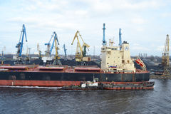 Cargo ship in the Riga port. Stock Images