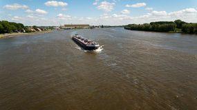 Cargo Ship on a River Stock Image