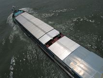 Cargo ship on a river. International transport and forwarding. Aerial view of a cargo ship Royalty Free Stock Images