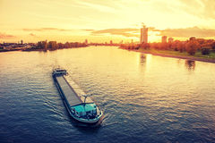 Cargo ship. In the river Rhine, Cologne, Germany at sunset Royalty Free Stock Image