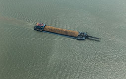Cargo ship on the river transporting sand Royalty Free Stock Image
