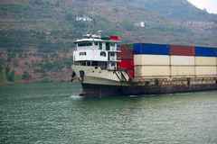 Cargo ship on river Stock Images