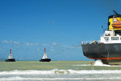 Cargo ship run aground on rocky shore Royalty Free Stock Image