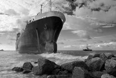 Cargo ship run aground on rocky shore Royalty Free Stock Photos