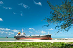 Cargo ship run aground on rocky shore Stock Photos