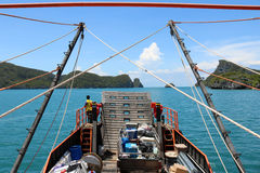 Cargo ship running between the islands. Stock Image
