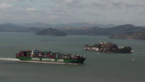 Cargo ship sail near Alcatraz Island in Sanfrancisco bay stock video footage