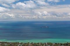 Cargo ship sailing across mornington peninsula. Royalty Free Stock Photo