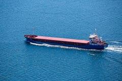 Cargo Ship Sailing in the Atlantic Ocean Royalty Free Stock Image