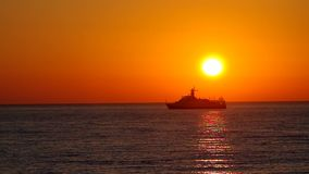Cargo ship sailing away Royalty Free Stock Images