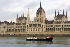 Barge on the background of the Parliament, famous sights of Budapest on a cloudy day stock images