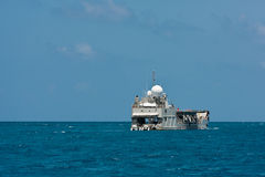 Cargo ship sailing in the Indian ocean Stock Photo