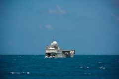 Cargo ship sailing in the Indian ocean Stock Photo