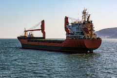 Cargo Ship Sailing in Ocean Stock Image