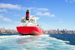 Cargo ship sailing out. Red cargo ship sailing in to Bosporus Sea Stock Photos