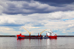 Cargo ship sailing on the river Stock Photography
