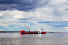 Cargo ship sailing on the river Royalty Free Stock Image