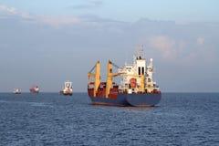 Cargo ship sailing the sea royalty free stock photo