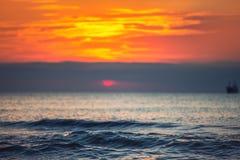 Cargo ship sailing in the sea, beautiful sunrise landscape Royalty Free Stock Photos