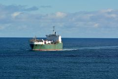 Cargo ship sailing in the sea. Commercial cargo ship sailing in the Tasman Sea from Australia to Tasmania stock photo
