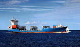 Cargo ship sailing in still water Stock Photos