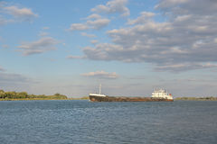 A cargo ship sails on the river Royalty Free Stock Photo
