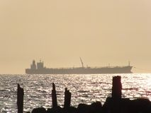 Cargo ship on the sea. Cargo ship sails on the sea stock photography