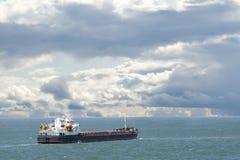 Cargo ship sails on the sea Stock Photography