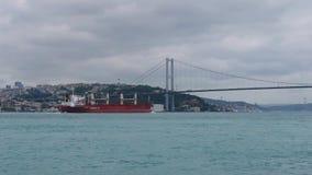 Cargo ship sails under the bridge Ataturk. Bosphorus. Istanbul. Turkey stock footage