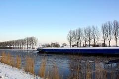 Cargo ship sails. Woltersum Stock Image