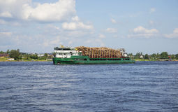 Cargo ship Salavat with the forest rising along the Neva river Royalty Free Stock Photos