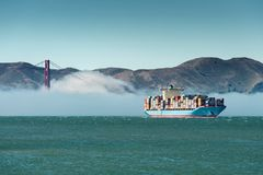 Cargo ship in San Francisco bay with a fog on a background Stock Images