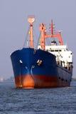 Cargo ship at sea stock photos