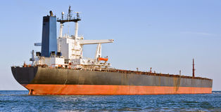 Cargo ship in the sea. A big cargo ship in the sea Stock Photo