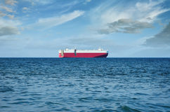 Cargo ship in the sea against the blue sky Stock Images