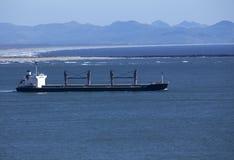 Cargo ship at sea stock photography