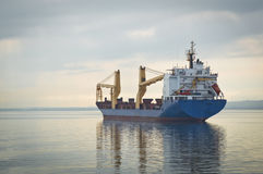 Cargo Ship at Sea Stock Images