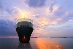 Cargo ship. Ship at the sea on sunset sky background Royalty Free Stock Photography