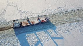 Cargo ship in the sea in winter. Aerial view of cargo ship in the sea in winter stock video footage