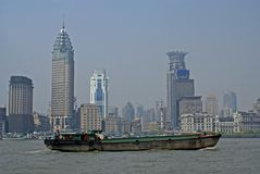 Cargo ship in Shanghai. A cargo barge on the huangpu river in Shanghai, china's economic capital Royalty Free Stock Image