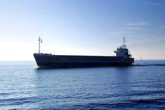 Cargo ship silhouette Royalty Free Stock Photos