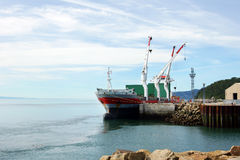 Cargo ship at small dock Royalty Free Stock Photography