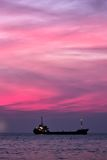 Cargo ship in South China Sea at dusk, Vietnam Royalty Free Stock Photo