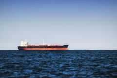 Cargo ship in still water near port of Gdansk, Poland. Royalty Free Stock Photography