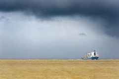 Cargo ship with stormy weather Stock Image