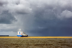 Cargo ship with stormy weather Royalty Free Stock Images