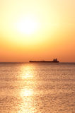 Cargo ship in sunrise Stock Photo