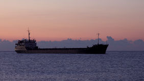 Cargo ship at sunrise Stock Photography