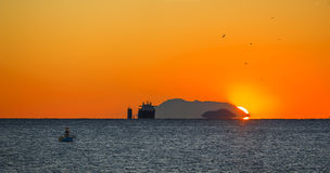Cargo ship at sunrising Stock Photos